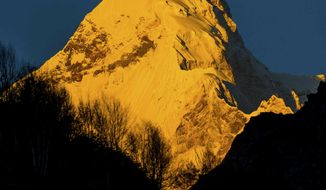 In this Oct. 8, 2016, photograph provided by Juniper Outdoor Pursuits Centre Pvt. Ltd., shows early morning light falling on Nanda Devi east base peak, seen from Pachu valley in Uttarakhand, India. Indian paramilitary soldiers have reached the bodies of seven of eight members from a team of international climbers believed killed on a notoriously dangerous Himalayan mountain, an official said Sunday. (Maninder Kohli/Juniper Outdoor Pursuits Centre Pvt. Ltd. via AP)