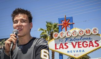 """FILE - In this May 2, 2019, file photo, """"Jeopardy!"""" sensation James Holzhauer speaks after being presented with a key to the Las Vegas Strip in front of the Welcome to Fabulous Las Vegas sign in Las Vegas. """"Jeopardy!"""" champion and professional sports gambler James Holzhauer is making his World Series of Poker debut in Las Vegas on Monday, June 24, 2019, with plans to donate half of his winnings to charity. (Caroline Brehman/Las Vegas Review-Journal via AP) ** FILE **"""