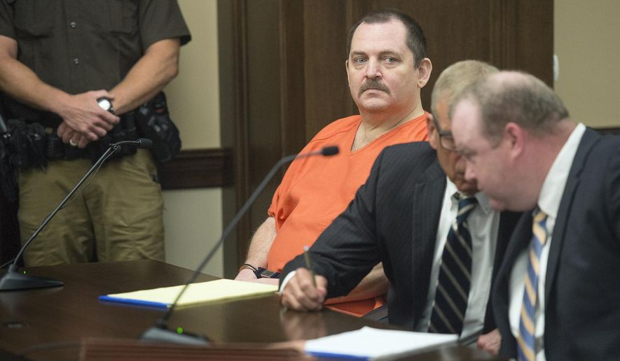 In this June 19, 2018 file photo, Aubrey Trail, left, looks on during a hearing in Saline County Court, in Wilbur, Neb. (Associated Press)