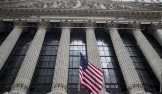"FILE - In this Nov. 20, 2018, file photo an American flag flies outside New York Stock Exchange. The SEC recently passed new regulations it says will ensure that brokers act in their clients' ""best interest."" (AP Photo/Mary Altaffer, File)"