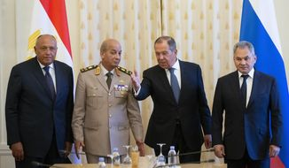 Russian Foreign Minister Sergey Lavrov, second right, welcomes for the talks Egyptian Defense Minister Mohamed Zaki, second left, Egyptian Foreign Minister Sameh Shoukry, left, and Russian Defense Minister Sergei Shoigu, right, during their meeting in Moscow, Russia, Monday, June 24, 2019. Egyptian President Abdel-Fattah el-Sissi has moved to increase military cooperation with Russia, and the two nation as foreign and defense ministers have held regular meetings. (AP Photo/Alexander Zemlianichenko)