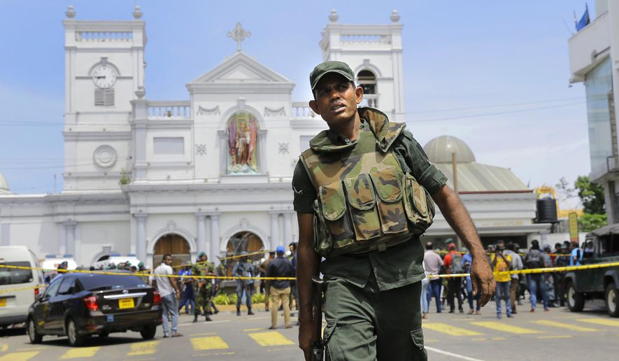 """FILE - In this April 21, 2019 file photo, Sri Lankan Army soldiers secure the area around St. Anthony's Shrine after a blast in Colombo, Sri Lanka. Sri Lanka's attorney general advised the acting police chief on Monday, June 24, 2019, to launch a criminal investigation of the former defense secretary over """"major lapses"""" that contributed to security failures ahead of Easter Sunday suicide bombings that killed more than 250 people. (AP Photo/Eranga Jayawardena, File)"""
