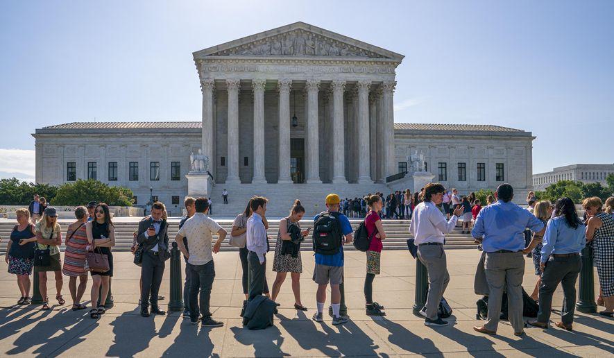 Visitors line up to enter the Supreme Court on Capitol Hill in Washington, Monday, June 24, 2019. (AP Photo/J. Scott Applewhite) ** FILE **