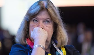 Sweden's IOC Executive Board Member Gunilla Lindberg, member of the candidate for the Olympic Winter Games 2026 Stockholm-Are delegation reacts as International Olympic Committee (IOC) president Thomas Bach from Germany announces that Milan-Cortina has won the bid to host the 2026 Winter Olympic Games, during the first day of the 134th Session of the International Olympic Committee (IOC), at the SwissTech Convention Centre, in Lausanne, Switzerland, Monday, June 24, 2019. Italy will host the 2026 Olympics in Milan and Cortina d'Ampezzo, taking the Winter Games to the Alpine country for the second time in 20 years. (Jean-Christophe Bott/Keystone via AP)