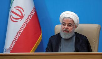 "Iranian President Hassan Rouhani described the White House as ""afflicted by mental retardation"" on Tuesday. Mr. Rouhani and President Trump have been exchanging escalating rhetorical jabs at one another. (ASSOCIATED PRESS) **FILE**"