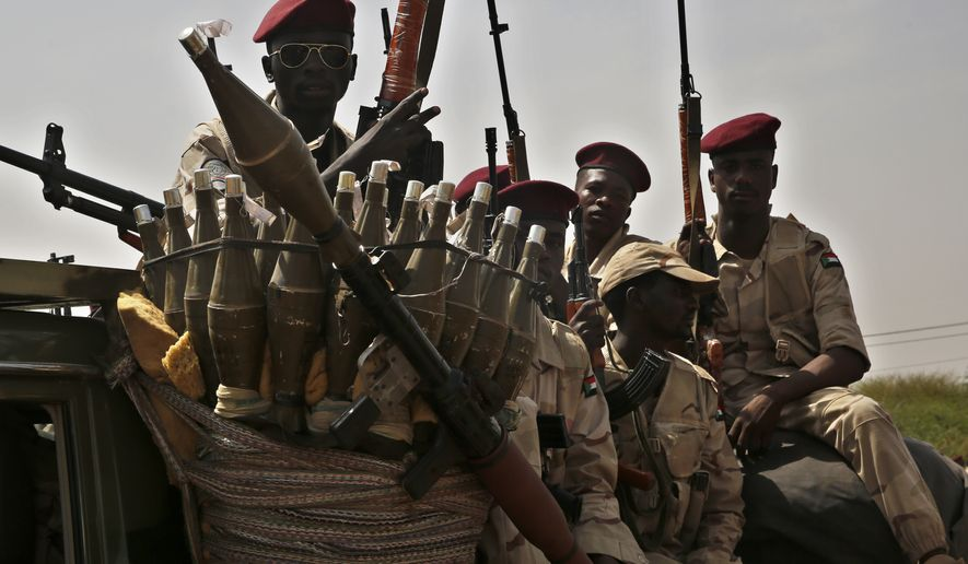 Sudanese soldiers from the Rapid Support Forces unit which led by Gen. Mohammed Hamdan Dagalo, the deputy head of the military council, secure the area where Dagalo attends a rally, in Khartoum, Sudan, Tuesday, June 18, 2019. On Monday, Sudan's protest leaders called for nighttime demonstrations and marches in the capital, Khartoum, and elsewhere in the country, amid a tense standoff with the ruling military over who should lead the transition after the ouster of the autocrat Omar al-Bashir. (AP Photo/Hussein Malla)