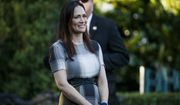 Stephanie Grisham, spokeswoman for first lady Melania Trump, watches as President Donald Trump and the first lady greet attendees during the annual Congressional Picnic on the South Lawn, Friday, June 21, 2019, in Washington. (AP Photo/Jacquelyn Martin)