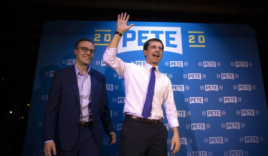 FILE - In this May 9, 2019 file photo, Democratic presidential candidate Pete Buttigieg, right, and husband, Chasten Glezman, acknowledge supporters after speaking at a campaign event in West Hollywood, Calif. A significant portion of US voters remains hesitant about supporting an LGBT candidate for president, according to a new AP-NORC poll. Yet many LGBT candidates in major non-presidential races have overcome such attitudes, and political experts predict the path for future LGBT office-seekers will steadily grow smoother.   (AP Photo/Jae C. Hong)