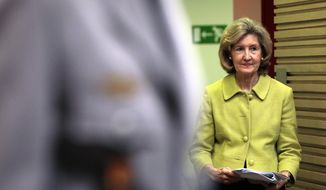United States Ambassador to NATO Kay Bailey Hutchison walks to the podium prior to a media conference at NATO headquarters in Brussels, Tuesday, June 25, 2019. (AP Photo/Virginia Mayo)