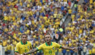 Brazil's Everton celebrates scoring his side's third goal against Peru during a Copa America Group A soccer match at the Arena Corinthians in Sao Paulo, Brazil, Saturday, June 22, 2019. (AP Photo/Victor R. Caivano)