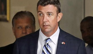 FILE - In this Aug. 23, 2018, file photo, Republican U.S. Rep. Duncan Hunter, R-Calif., leaves an arraignment hearing in San Diego after he and his wife, Margaret, pleaded not guilty to charges they illegally used his campaign account for personal expenses. Federal prosecutors say Hunter illegally used campaign funds to finance romantic flings with a series of women, spending thousands of dollars on meals, drinks and vacations. Allegations about the married Republican congressman's affairs were outlined in a government court filing late Monday, June 24, 2019, connected to charges he and his wife misspent more than $200,000 on trips and personal expenses. (AP Photo/Gregory Bull, File)