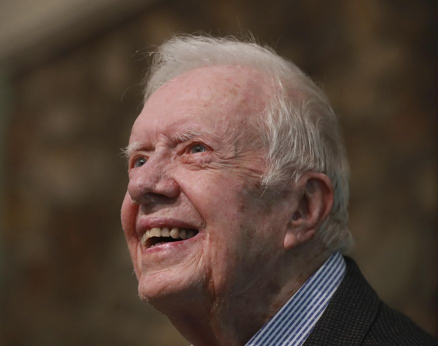 In this June 9, 2019 file photo, former President Jimmy Carter smiles as he returns to Maranatha Baptist Church to teach Sunday School, less than a month after falling and breaking his hip, in Plains Ga.  (Curtis Compton/Atlanta Journal-Constitution via AP, File) **FILE**