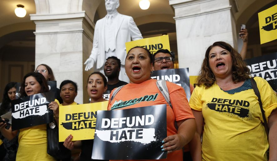 Protesters gather to demand the defunding of government agencies for border protection and customs enforcement, Tuesday, June 25, 2019, on Capitol Hill in Washington. (AP Photo/Patrick Semansky)