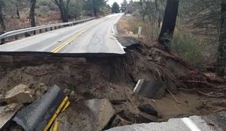 FILE - This Feb. 15, 2019, file photo, released by Caltrans District 8 shows storm damage to the San Jacinto Mountains Highway 243 near Idyllwild, Calif. The scenic highway leading to the Southern California mountain resort of Idyllwild will remain closed for months as crews repair substantial damage caused by winter and spring storms. Officials say it could stay closed until next year. (Caltrans District 8 via AP, File)