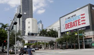In this June 24, 2019, photo, a billboard advertises the Democratic Presidential Debates across from the Knight Concert Hall at the Adrienne Arsht Center for the Performing Arts of Miami-Dade County, in Miami. Don't envy NBC News executive Rashida Jones, who is behind this week's inaugural Democratic presidential debate and will have to juggle 20 candidates, five news personalities and, it's likely, one tweeting president. (AP Photo/Lynne Sladky)