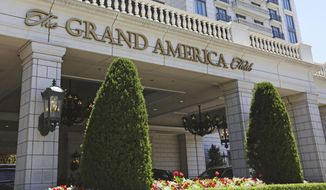 This Sunday, June 23, 2019, photo, shows the Grand America Hotel in Salt Lake City. A lawsuit filed Tuesday, accuses the luxury Grand America Hotel in Salt Lake City of luring workers from the Philippines to a program that promised training and cultural immersion but instead forced them to work long hours doing menial jobs for low pay. (AP Photo/Rick Bowmer)