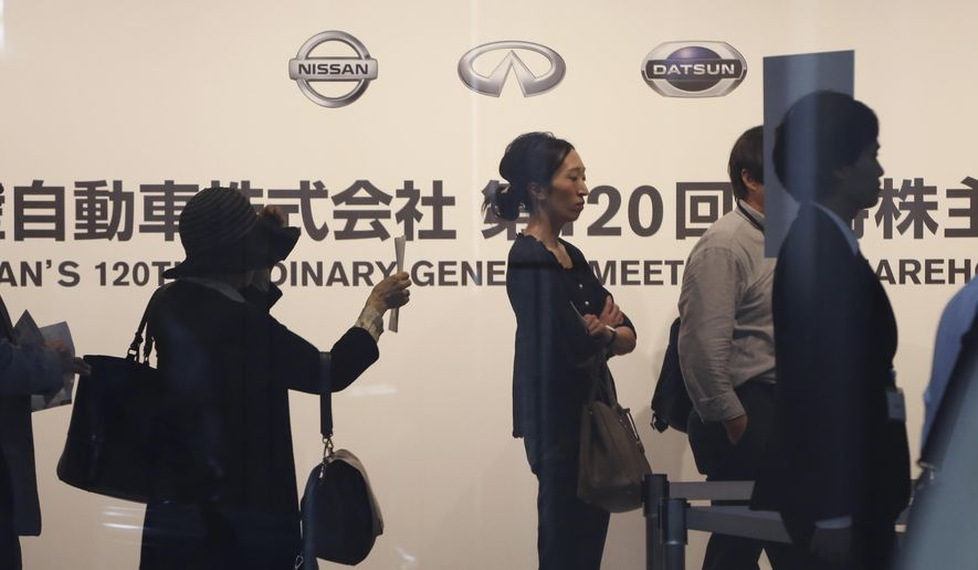 Shareholders arrive for Nissan's general meeting of shareholders in Yokohama, near Tokyo, Tuesday, June 25, 2019. Japanese automaker Nissan faces shareholders as profits and sales tumble after its former star chairman faces trial on financial misconduct allegations.(AP Photo/Koji Sasahara)