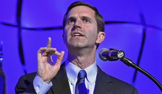 FILE - In this May 21, 2019 file photo, Kentucky Attorney General Andy Beshear addresses his supporters following his victory in the Democratic primary for governor in Louisville, Ky. Gov. Matt Bevin predicted Tuesday, June 25, 2019 that his political kinship with Republican President Donald Trump will be in the campaign spotlight this year, and that Trump may visit Kentucky multiple times to help Bevin counter a tough Democratic challenge. (AP Photo/Timothy D. Easley, File)
