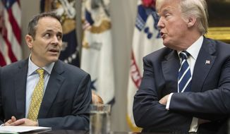 FILE - In this Thursday, Jan. 11, 2018, file photo, President Donald Trump, right, and Kentucky Gov. Matt Bevin, left, talk during a prison reform roundtable in the Roosevelt Room of the Washington. Bevin predicted Tuesday, June 25, 2019  that his political kinship with Trump will be in the campaign spotlight this year, and that Trump may visit Kentucky multiple times to help Bevin counter a tough Democratic challenge.  (AP Photo/Carolyn Kaster, File)