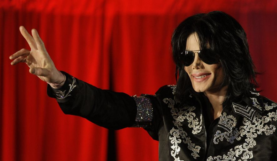 This March 5, 2009, file photo shows Michael Jackson as he announces ten live concerts at the London O2 Arena in south London. Tuesday, June 25, 2019, marks the 10th anniversary of Jackson's death. (AP Photo/Joel Ryan, File)