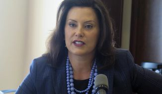 Gov. Gretchen Whitmer speaks with reporters at a budget briefing on Tuesday, June 25, 2019, at the Romney Building in Lansing, Mich. The Democrat says the Republican-led Legislature should not have begun a summer break without a budget deal or an agreement to spend more to fix the roads. (AP Photo/David Eggert)