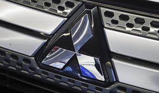 FILE - This Feb. 14, 2019, file photo shows the Mitsubishi logo on the front grill of a 2019 Mitsubishi Outlander GT on display at the 2019 Pittsburgh International Auto Show in Pittsburgh. Mitsubishi Motors on Tuesday, June 25, announced it is relocating its North America headquarters from California to Tennessee, a move that will bring the Japanese automaker closer to its sister company Nissan and strengthen Tennessee's growing reputation as an epicenter of the automotive sector. (AP Photo/Gene J. Puskar, File)