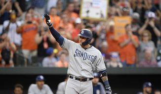 San Diego Padres' Manny Machado acknowledges the crowd during the first inning of a baseball game against his former team, the Baltimore Orioles, Tuesday, June 25, 2019, in Baltimore. (AP Photo/Nick Wass)