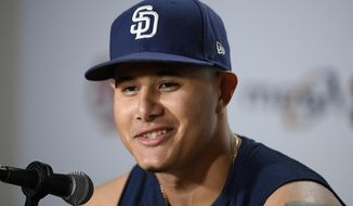 San Diego Padres' Manny Machado talks to the media before a baseball game against the Baltimore Orioles, Tuesday, June 25, 2019, in Baltimore. (AP Photo/Nick Wass)