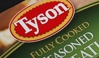 FILE - This Nov. 18, 2011, file photo, shows a Tyson food product, in Montpelier, Vt. The Department of Justice tipped its hand last week when it requested a temporary halt to discovery proceedings in a 2016 class-action lawsuit filed by food distributor Maplevale Farms. Maplevale accuses Tyson Foods Inc., Perdue Farms Inc. and others of conspiring to fix poultry prices between 2008 and 2016. (AP Photo/Toby Talbot, File)