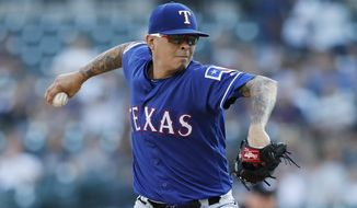 Texas Rangers starting pitcher Jesse Chavez winds up during the first inning of the team's baseball game against the Detroit Tigers, Tuesday, June 25, 2019, in Detroit. (AP Photo/Carlos Osorio)
