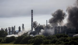 A plume of smoke rises during a fire at Indorama Ventures petrochemical plant in San Roque, near Algeciras, southern Spain, Tuesday, June 25, 2019. Authorities have evacuated nearby homes and closed roads around the plant, located about 650 kilometers (400 miles) south of Madrid. (AP Photo/Javier Fergo)