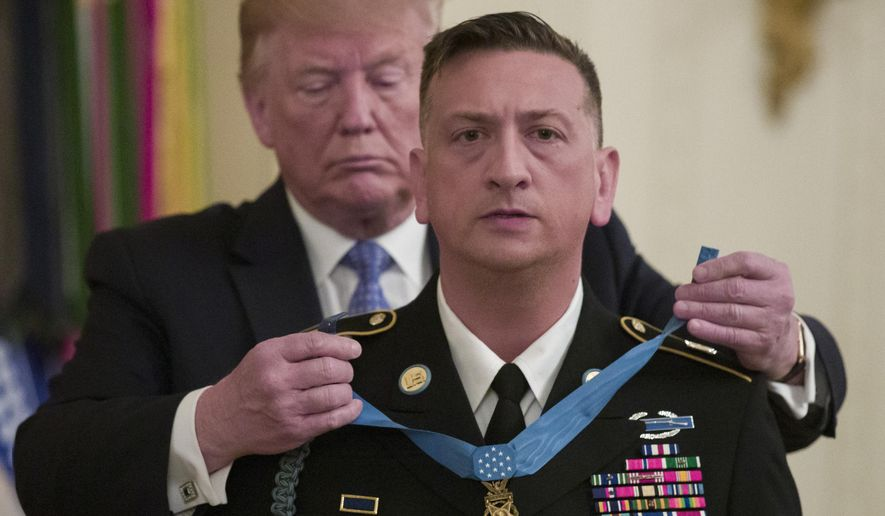 President Donald Trump awards the Medal of Honor to Army Staff Sgt. David Bellavia in the East Room of the White House in Washington, Tuesday, June 25, 2019, for conspicuous gallantry while serving in support of Operation Phantom Fury in Fallujah, Iraq. (AP Photo/Alex Brandon)