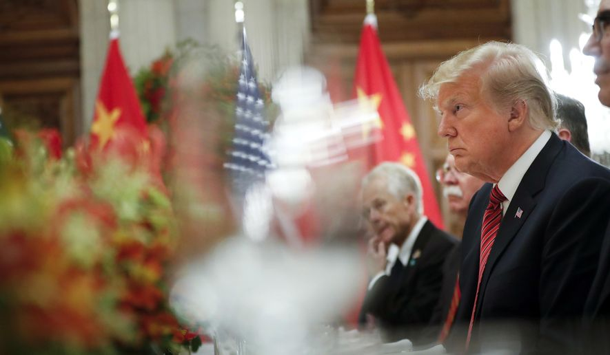 FILE - In this Dec. 1, 2018, file photo President Donald Trump listens to China's President Xi Jinping speak during their bilateral meeting at the G20 Summit in Buenos Aires, Argentina. Trump meets with President Xi Jinping at the G-20 meeting in Japan this week. (AP Photo/Pablo Martinez Monsivais, File)