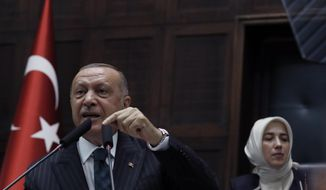 Turkey's President Recep Tayyip Erdogan addresses his ruling party MPs, in Ankara, Turkey, Tuesday, June 25, 2019, two days after Ekrem Imamoglu, the candidate of the secular opposition Republican People's Party, won the election for mayor of Istanbul. Erdogan addressed his AK Party's weekly meeting, the first time he speaks since the Istanbul mayoral election Sunday, which was a big setback for him and his party.(AP Photo/Burhan Ozbilici)