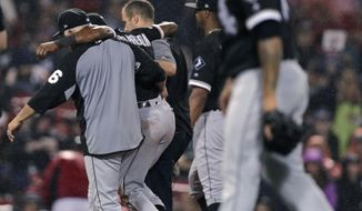 Chicago White Sox's Tim Anderson is helped from the field after an injury during the fifth inning of a baseball game against the Boston Red Sox at Fenway Park in Boston, Tuesday, June 25, 2019. (AP Photo/Charles Krupa)