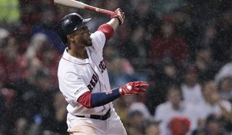 Boston Red Sox's Xander Bogaerts watches the flight of his two-run home run during the fifth inning of a baseball game against the Chicago White Sox at Fenway Park in Boston, Tuesday, June 25, 2019. (AP Photo/Charles Krupa)