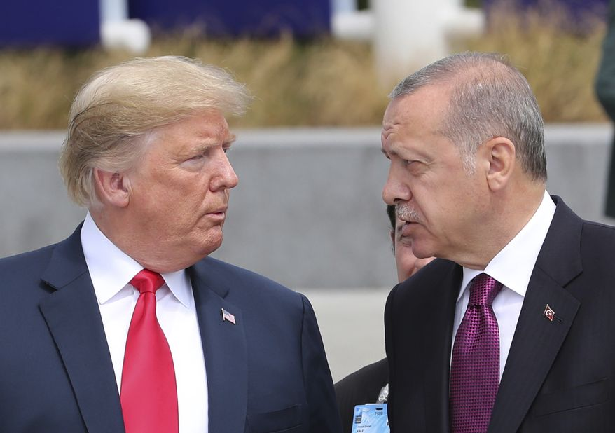 U.S. President Donald Trump, left, talks to Turkish President Recep Tayyip Erdogan, right, as they tour the new NATO headquarters in Brussels, Belgium, Wednesday, July 11, 2018. NATO countries' heads of states and governments gather in Brussels for a two-day meeting. (Presidency Press Service via AP, Pool)