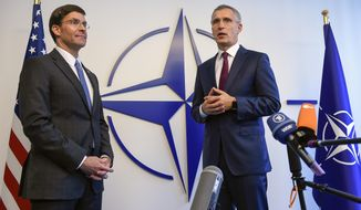 Acting U.S. Secretary for Defense Mark Esper, left, speaks during a press point with NATO Secretary General Jens Stoltenberg prior to a meeting of NATO defense ministers at NATO headquarters in Brussels, Wednesday, June 26, 2019. (John Thys, Pool Photo via AP)