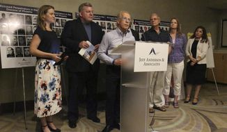 """Jeff Anderson, an attorney and advocate for clergy sex abuse victims, speaks at a news conference in Phoenix on Wednesday, June 26, 2019, where he called on the Phoenix Diocese of the Roman Catholic church to disclose the names of all priests accused of abuse. Behind Anderson are victims, advocates and a former priest. Anderson released a list of 109 clerics he said abused children in the Phoenix area; the diocese lists 43 priests who have been """"credibly accused"""" of abuse since 1969. (AP Photo/Bob Christie)"""