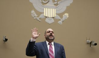 "Special Counsel Henry Kerner is sworn in to testify before the House Oversight and Reform Committee about his findings that presidential counselor Kellyanne Conway repeatedly violated the Hatch Act, a federal law that limits political activity by government workers, on Capitol Hill in Washington, Wednesday, June 26, 2019. Conway was labeled a ""repeat offender"" of the Hatch Act by disparaging Democratic presidential candidates while speaking in her official capacity during television interviews and on social media. (AP Photo/J. Scott Applewhite)"