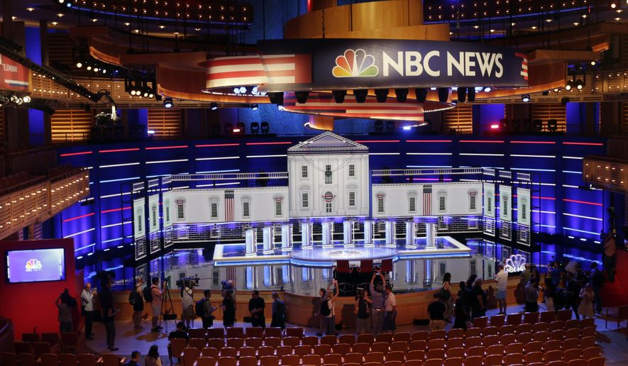 Members of the media gather for a walk-through of the stage set-up for the first democratic debate, Wednesday, June 26, 2019. (AP Photo/Marta Lavandier) ** FILE **