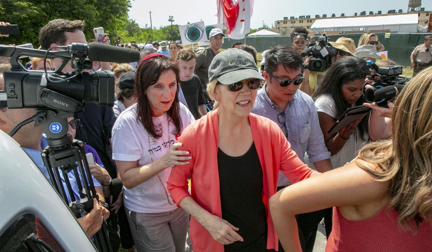 Democratic presidential candidate Sen. Elizabeth Warren, D-Mass., is swarmed by the media while walking past the Homestead Detention Center, where the U.S. is detaining migrant teens, in Homestead, Fla., Wednesday, June 26, 2019. (Daniel A. Varela/Miami Herald via AP) ** FILE **