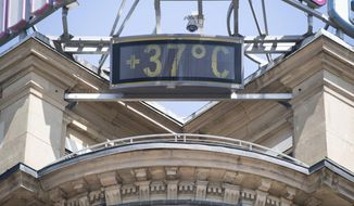 A sign shows 37 degrees Celsius at a building in the city of Stuttgart, Germany, Wednesday, June 26, 2019. Germany and Europe is hit by a heatwave with temperatures near 40 degrees. (Marijan Murat/dpa via AP)