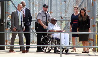 FILE - In this May 23, 2019, file photo, Charles Ray Finch is wheeled out of the Greene Correctional Institution in Maury, N.C. Finch, a North Carolina man who was once on death row for a shopkeeper's slaying, won't be retried in the case that put him behind bars for more than 40 years. (Drew C. Wilson/The Wilson Times via AP, File)