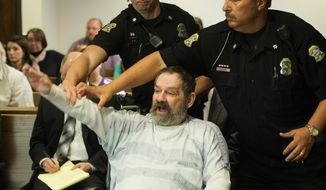 """FILE - In this Nov. 10, 2015, file photo, Frazier Glenn Miller Jr., convicted of capital murder, attempted murder and other charges, gestures as Johnson County deputies remove Miller from the courtroom during the sentencing phase of his trial at the Johnson County District Court in Olathe, Kan. A recent Kansas Supreme Court ruling declaring that the state constitution protects access to abortion has opened the door to a new legal attack on the death penalty. Attorneys for five of the 10 men on death row in Kansas, including Miller Jr., argue that the abortion decision means the state's courts can enforce the broad guarantees of """"life, liberty and the pursuit of happiness"""" in the Bill of Rights in the Kansas Constitution.   (Joe Ledford/The Kansas City Star via AP, Pool, File)"""