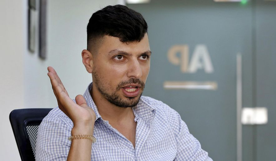 In this Thursday, June 20, 2019, photo, Mohammed Awwad, 27, a Lebanese Muslim who was prevented from renting an apartment in the Christian village of Hadat, speaks during an interview with The Associated Press in Beirut, Lebanon. The town's Muslim ban, imposed years ago, has recently sparked a national outcry. The case reflects Lebanon's rapidly changing demographic make-up against the backdrop of deep-rooted sectarian divisions that once erupted into a 15-year civil war. (AP Photo/Bilal Hussein)