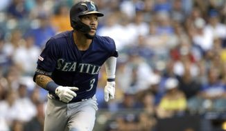 Seattle Mariners' J.P. Crawford watches his RBI triple during the second inning of the team's baseball game against the Milwaukee Brewers on Wednesday, June 26, 2019, in Milwaukee. (AP Photo/Aaron Gash)