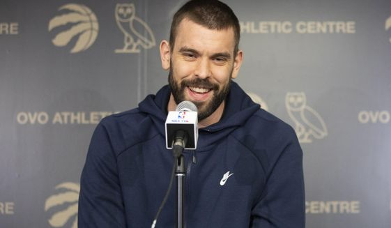 Toronto Raptors' Marc Gasol takes questions from the media during an NBA basketball news conference following their NBA Championship win, in Toronto, Sunday, June 16, 2019. (Chris Young/The Canadian Press via AP)