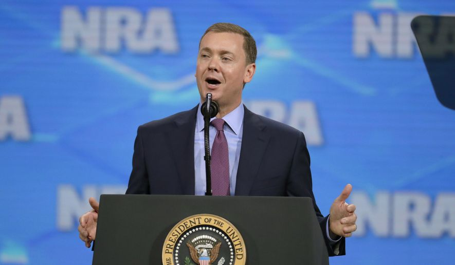 In this April 26, 2019, file photo, National Rifle Association Institute for Legislative Action Executive Director Christopher W. Cox speaks at the NRA-ILA Leadership Forum in Lucas Oil Stadium in Indianapolis. The National Rifle Association's top lobbyist has resigned in another sign of infighting within the powerful gun lobbying group, Wednesday, June 26, 2019. Cox's departure comes just days after the NRA placed him on administrative leave, claiming he was part of a failed attempt to extort the longtime CEO. (AP Photo/Michael Conroy, File)