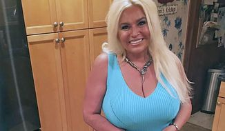 """This 2017 photo provided by Mona Wood-Sword shows Beth Chapman in Honolulu. Chapman, the wife and co-star of """"Dog the Bounty Hunter"""" reality TV star Duane """"Dog"""" Chapman, died of cancer on Wednesday, June 26, 2019. She was 51. (Mona Wood-Sword via AP, File)"""